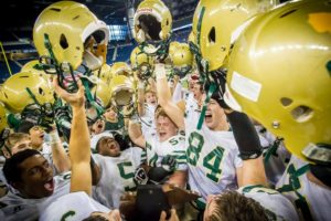 The Muskegon Catholic Central Crusaders finish with a 12-2 record, district and regional titles and a coveted state title. Photo/Tim Reilly