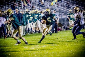 Tommy Scott scrambles for a rushing TD last week versus Fulton. Photo/Tim Riley