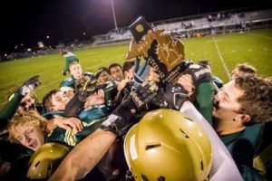 The Crusaders celebrate with the district title trophy, its seventh in the past nine years. Photo/Tim Riley