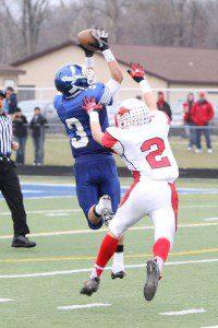 Oakrige's Dom Greenawalt halls in the catch over a Millington defender. Photo/Jeff Peterson