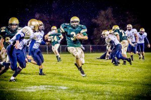Nicholas Holt finds a seam for the touchdown run Friday night in the Crusaders' Div. 8 opener versus Fulton. Photo/Tim Riley