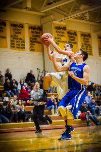Dom Greenewalt drives to the basket for Oakridge. Photo/Tim Reilly
