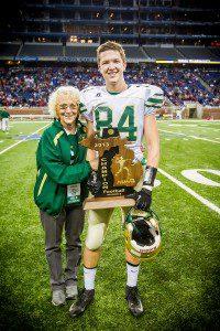Tyler with her grandson, Muskegon Catholic Central senior Ian Tyler. Photo/Tim Riley