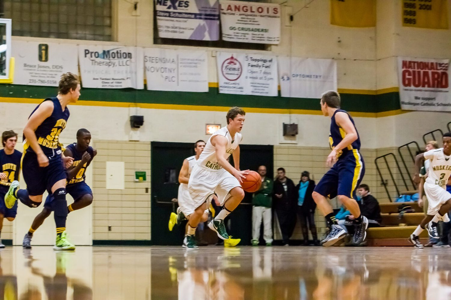 After terrific start, Muskegon Catholic nearly succumbs to late Norse charge in boys hoops opener