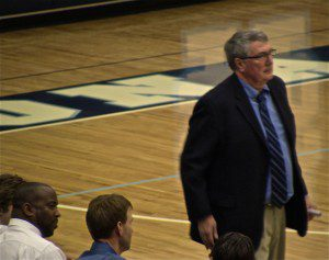 Mona Shores Head coach Gene Gifford assesses the action during his first game coaching for the Sailors.