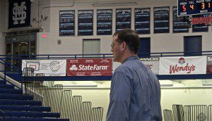 Mona Shores girls basketball coach Brad Kerth looks on during first-half action. Photo/Jason Goorman
