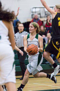 Anneliese DeKam drives to the basket for WMC. Photo/Randy Riksen