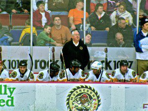 Coach Ron Stephenson looks on as his Muskegon squad takes on the Detroit Red Wing alumna.