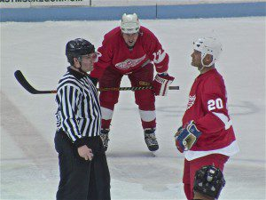 Red Wings alumn No. 20 Bryan Smolinski prepares for a faceoff as Fwd. Wayne Presley gets read. Photo/Jason Goorman