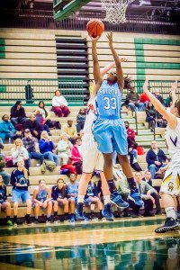 Jasmyn Walker rises up for a layup in Mona Shores' win over defending Class A state champion Grand Haven. Photo/Tim Reilly