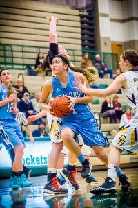 Mona Shores' Amy Gillings drives through the lane in against Grand Haven. Photo/Tim Reilly
