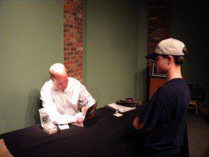 Former MLB pitcher Jim Abbott signs Karson Kriger's book.