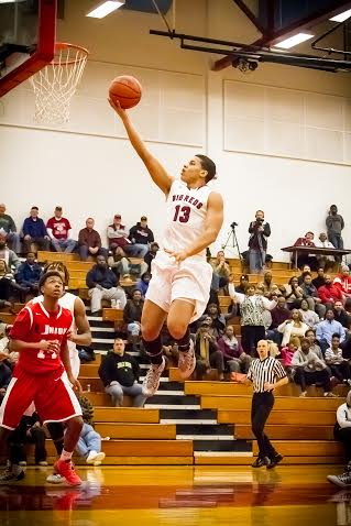 Muskegon junior forward Jamel French going in for a layup versus Union. Photo/Tim Reilly