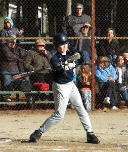 Karson Kriger sports a prosthetic arm which enables to him to bat in baseball. The Fruitport freshman anticipates being a consistent contributor for his trojans this Spring.