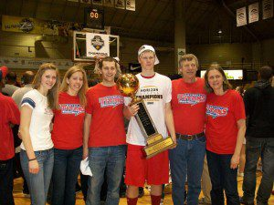 Evan Bruinsma stands with Rachel, Janet, William and his parents Henry and Margret with the 2012 Horizon League championship trophy. Evan currently is in his senior season at University of Detroit and is averaging 12.5 ppg and 7.7 rpg.