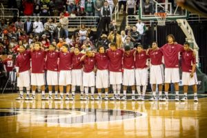 Muskegon Big Reds stand together during the National Anthem of the Class A state finals. Photo/Tim Reilly
