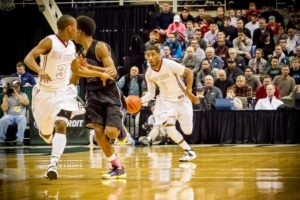 Deshaun Thrower dribbles the ball up the floor during the Big Reds Class A state final win. Photo/Tim Reilly
