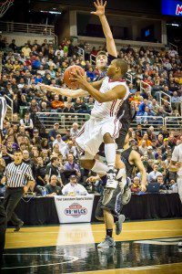 Will Roberson on another And-1 play for Muskegon. Photo/Tim Reilly