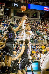 Deshaun Thrower puts up a shot in the paint during Muskegon's Class A state championship win. Photo/Tim Reilly