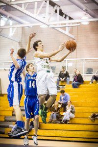 Dominic Woodard drives the lane for Muskegon Catholic Central. Photo/Tim Reilly