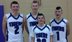 Andrew, Jeffrey, Danny, and Jason Beckman all play on this year's Shelby Tiger Basketball team. The Tigers face Montague in the Class C district finals on Friday.
