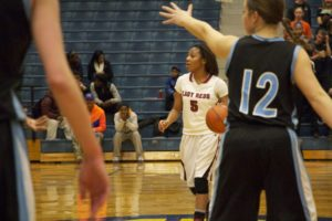 Raven Moore takes the ball up the floor for Muskeogn. Photo/Jason Goorman