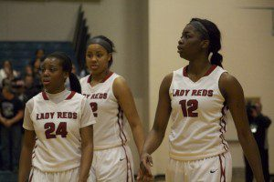 No. 24 Janiece Levelston, Jade Page and Mardreika Cook check in for Muskegon during a break in play. Photo/Jason Goorman