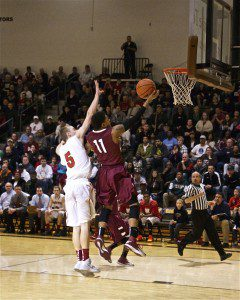 Jason Loera goes in for the Big Red layup as Northview's Ryan Kapustka contests the shot.