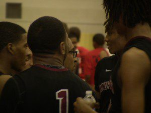 Muskegon coach Keith Guy talks with his players during action against Grand Rapids Union.