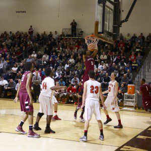 Joeviair Kennedy completes the dunk for Muskegon.