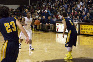 Will Roberson sets up the Big Red's offense during third quarter action against Hudsonville. Photo/Jason Goorman