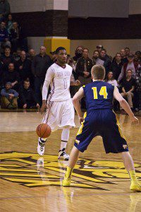 Deshaun Thrower dribbles the ball up the court for Muskegon. Photo/Jason Goorman
