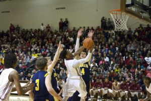 Deshaun Thrower gets to the basket for Muskegon. Photo/Jason Goorman