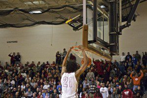 Deyonta Davis jams home two points for Muskegon on a third-quarter run. Photo/Jason Goorman
