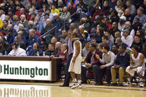 Coach Keith Guy talks with Will Roberson during a Hudsonville free throw. Photo/Jason Goorman