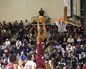 Muskegon's Deyonta Davis flies in for the dunk. Photo/Jason Goorman