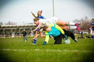 Adeline Bonnette goes in hard for MCC on the Tri-unity keeper. Photo/Tim Reilly