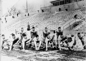 Earl Morrall stands with his 1951 Muskegon Big Reds team at Hackley Field.