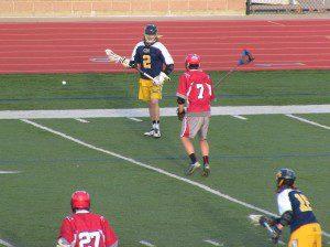 Trevor McNamara controls the ball as Spring Lake's Tyler Strandberg looks to defend. Photo/Jason Goorman