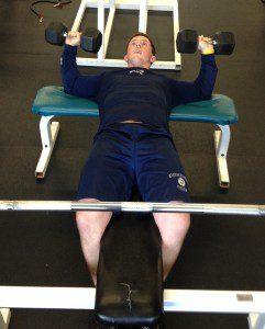 Duff works on Johnson's exercise program.