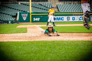 Griffen Seymour slides safely into home for MCC at Comerica Park. Photo/Tim Reilly