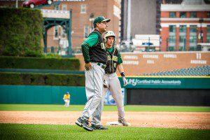 Head coach Steve Schuitema talks strategy with Alex Lewandoski. Photo/Tim Reilly