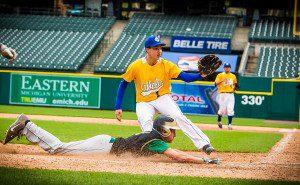 Alex Lewandoski scores on the wild pitch. Photo/Tim Reilly