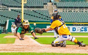 Nick Holt dives into home plate to complete an inside the park home run at Comerica Park. Photo/Tim Reilly