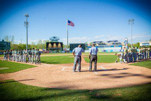 Muskegon Catholic and Grand Rapids West Catholic stand on the third and first baselines for the National Anthem at 5th 3rd Ball Park on Friday. Photo/Tim Reilly