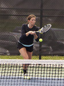 Clare Deyoung returns a shot during GMAA city tournament action at Whitehall on May 3. Photo/Jason Goorman