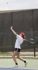 Carlie Bishop unleashes for her second serve during action at the GMAA city tennis tournament. Photo/Jason Goorman
