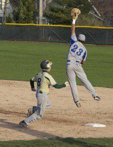 Oakridge's Jame Abriatis leaps to catch a high throw to fist on a Alex Lewandoski hit. Photo/Jason Goorman
