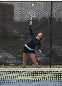 Deyoung on the serve during the GMAA's annual city tennis championships.