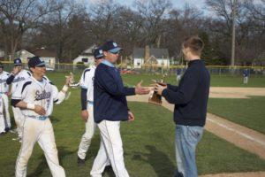 Mona Shores coach Bill Lent accepting the GMAA City Baseball championship trophy. Photo/Jason Goorman